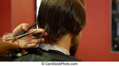 Man getting his hair cut by hairdresser 4k - Man getting his...