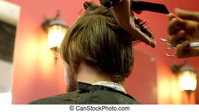 Man getting his hair trimmed with scissor 4k - Man getting...