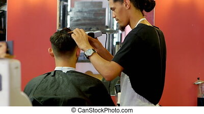 Man getting his hair trimmed with trimmer 4k - Man getting...
