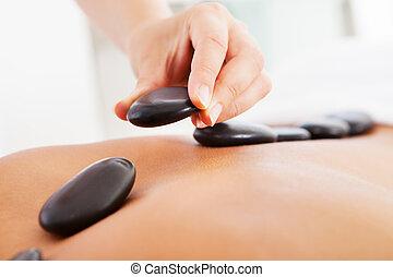 Man Getting Hot Stone Massage