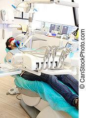 Man getting laser on teeth for whitening in dentist studio