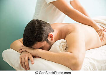 Man getting massage at a spa