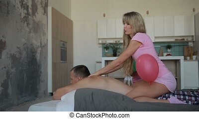 Man getting massage from his beloved wife at home