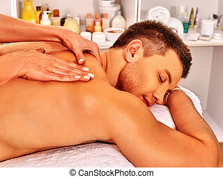 Man getting massage in spa.