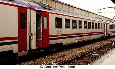 Man getting off train