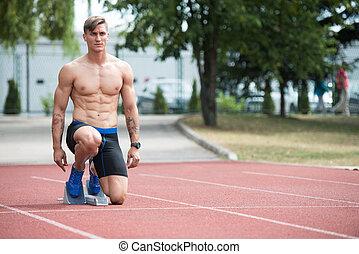 Man Getting Ready to Start Running
