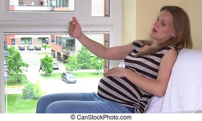 Man give a hand to help her pregnant tired woman stand up