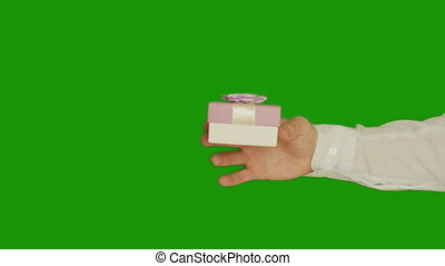 A man gives a woman a gift in a small box with a bow, chroma key