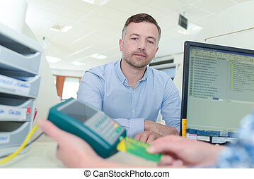 man giving a card to a doctor