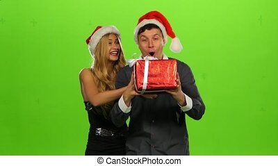 man giving a Christmas present to his surprised girlfriend. green screen