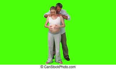 Man giving a massage to his pregnant wife