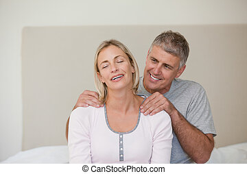 Man giving a massage to his wife