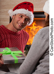 Man giving a present to her girlfriend
