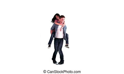 Man giving a woman a piggy-back ride in slow motion