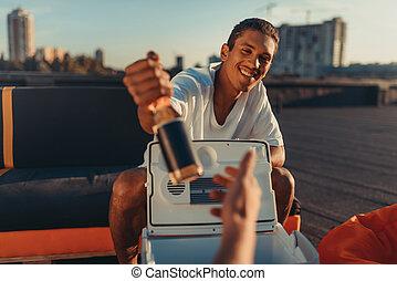 man giving beer at camera