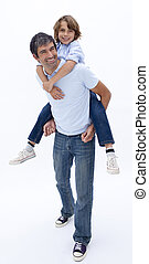 Man giving boy piggyback ride