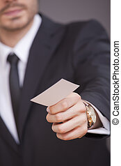 man giving business card