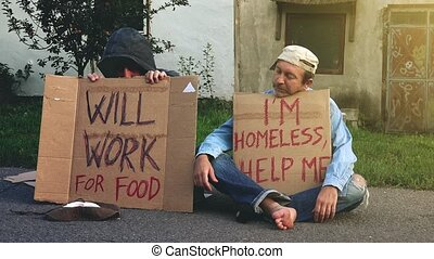 Man giving change to homeless