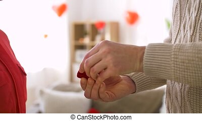 man giving diamond ring to woman at valentines day - ...