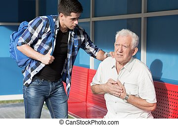 Man giving first aid