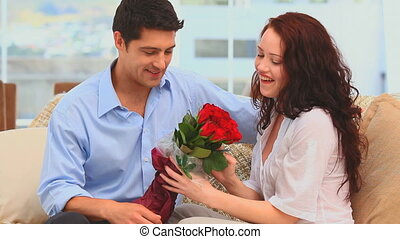 Man giving flowers at his wife