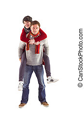Man giving girlfriend piggy back on white background