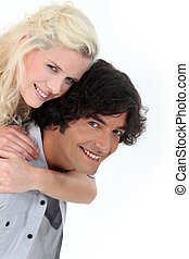 Man giving girlfriend piggyback