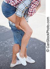 Man giving his girlfriend a piggy back