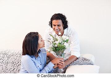 Man giving his girlfriend flowers