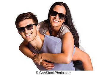 Man giving his pretty girlfriend a piggy back
