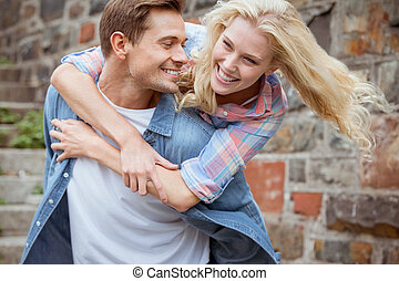 Man giving his pretty girlfriend a