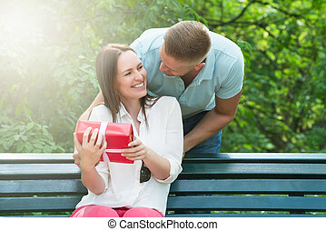 Man Giving His Wife A Gift