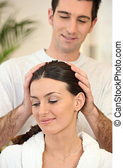 Man giving his wife a head massage
