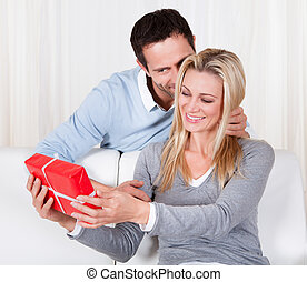 Man giving his wife a surprise gift