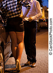Man giving money to prostitute