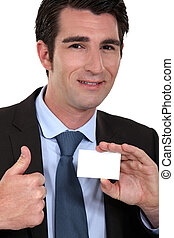 Man giving ok gesture whilst holding business card
