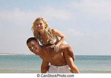 Man giving piggyback ride