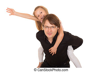 Man giving piggyback ride to a little girl