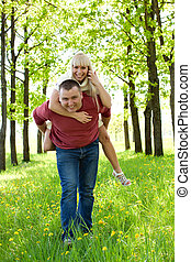 Man giving piggyback ride to woman