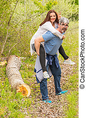 Man giving piggyback to his wife