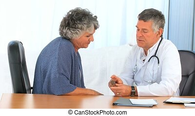 Man giving pills to his patient