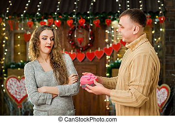 man giving present to his young girl