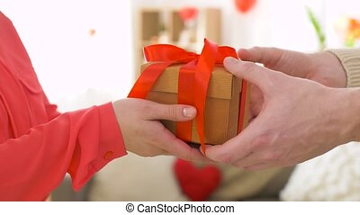 man giving present to woman at valentines day