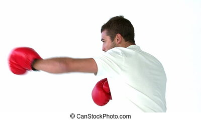 Man giving punches with boxing gloves in front of the camera...