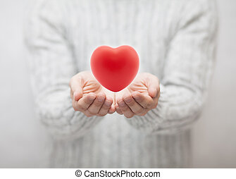 Man giving red heart. Love concept