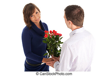 man giving roses to his wife