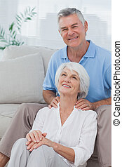 Man giving shoulder massage to wife