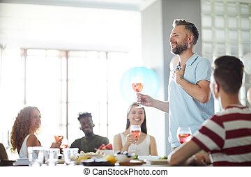 Man Giving Speech at Banquet