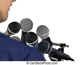Man Giving Speech Using Microphones