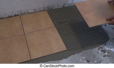 man glue tile home floor